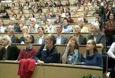 CERN Physicists Watch Higgs Boson Presentation