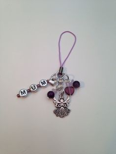 Mum charm made with acrylic silver letter beads, seed beads and Czech glass beads. At the bottom hangs a antique silver angel. Ideal as a mobile charm, key charm, purse charm or handbag charm Will come tissue paper wrapped and in a gift bag Posted Tissue Paper Wrapping, Letter Beads, Lilac, Purple, Czech Glass Beads, How To Make Beads, Seed Beads, Antique Silver, Belly Button Rings