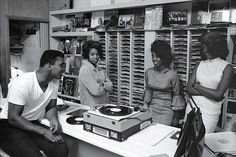 Muhammad Ali and some female fans spin records in 1965.
