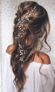 **I think this look is really beautiful as it has a boho twist to it with light curls and flowers running through it.** pulled back loose waves - lovely long wedding hairstyle ~ we ❤ this! moncheribridals.com
