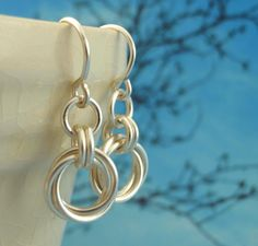 Silver Hoop Earrings - Small Linked Loops II -The Softer Side of Chainmaile. $12.00, via Etsy.