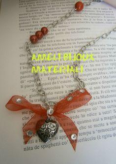 collana handmade con cuore argentato e nastro in organza rosso