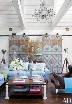 Rustic Living Room by Martyn Lawrence Bullard Design in Los Angeles, California
