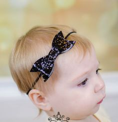 Check out this item in my Etsy shop https://www.etsy.com/listing/256305442/black-glitter-bow-headband-photo-prop