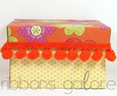 pom pom trim used to decorate a gift box  #ribbonsgalore