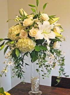Tall centerpiece with free flowing feel - hydrangea, lilies, roses and greenery- so pretty