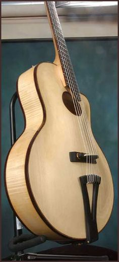 Thorell archtop acoustic guitar with oval sound-hole.