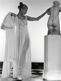 Lisa Fonssagrives posing with sculpture. Photographed at Helena Rubenstein's apartment for Harper's Bazaar by Louise Dahl-Wolfe, 1945.