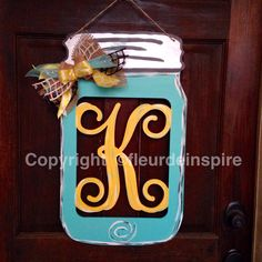 Yellow and turquoise Mason jar door hanger by fleur-de-inspire Painted Ornaments, Wooden Ornaments, Painted Wood Signs, Painted Mason Jars, Wooden Signs, Wooden Painting, Monogram Painting, Painted Monogram, Double Sliding Barn Doors