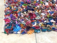 Image from http://www.secondnatureonline.co.uk/wp-content/uploads/2013/09/RG046-Vintage-Style-Rag-Rug-Close-Up.jpg.