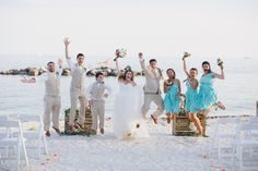 Jubilant Wedding Party Jumps on the Beaches of Key West. Seafood dresses by Coralie Beatrix