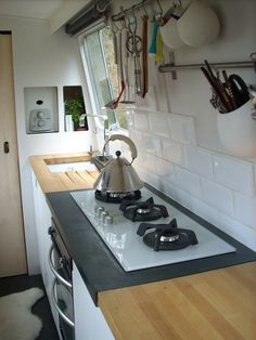 Ikea kitchen system in an rv. I like the cutting board counter but it looks heavy