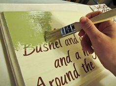 place stickered letters on wooden sign, paint, then peal off stickers. much easier than handwriting!.