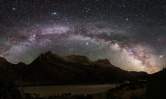 """The spectacular Milky Way over Dinosaur National Monument. The """"Prancing Horse"""" nebula—a feature of the dust cloud that appears as the silhouetted image of a horse with its fore legs raised—is visible at the bottom right."""