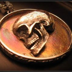 Sterling silver half skull carved by yours truly. It was mounted on a bronze disk with silver backing and encircled in a patterned silver border. This and others are for sale on my Facebook page Norwood 's of Nashville  #nashville #norwoodsofnashville  #skull #silver #pendant #jewelry