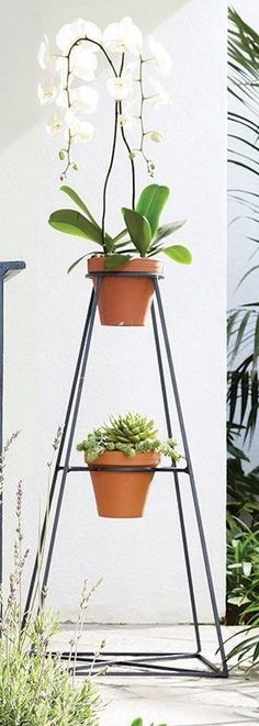 Constructed from clean, graphic lines made of cast aluminum, this striking obelisk plant stand is designed to hold two 6-inch pots, creating a focal point whether displayed indoors or out. Trough Planters, Ceramic Planters, Garden Planters, Planter Pots, Garden Oasis, Pastel Yellow, Hand Painted Ceramics, Indoor Outdoor Rugs, Clay Pots