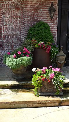 """Nothing says, """"Entrez Sil Vous Plait"""" more than cheerful pops of color at a front door."""