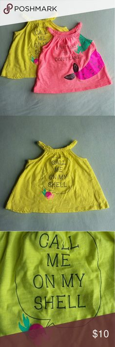 2 Mermaid Summer Tank Tops Size 9-12 Months EUC really cute fluorescent tops with split backs and mermaid graphics. Only worn by my daughter once. One owner. Call me on my shell and mermaid hair don't care. Willing to measure upon requests. Pet and smoke free home. Koala Kids Shirts & Tops Tank Tops