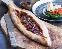 harrisa flat bread with  olive jalapeno topping