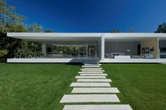 Designer Steve Hermann created one of the year's best works of residential architecture, the Glass Pavilion House of Montecito, California.  This home bears a visual relation to the famed Farnsworth House by Mies van der Rohe, but perhaps improves upon the classic.