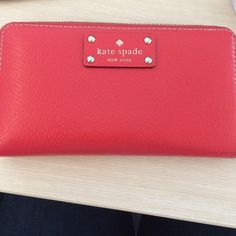 Red Kate Spade Wallet extremely great condition with very minor ware! Goes great with anything. Red makes the wallet pop! Perfect gift. Price negotiations accepted :) kate spade Bags Wallets