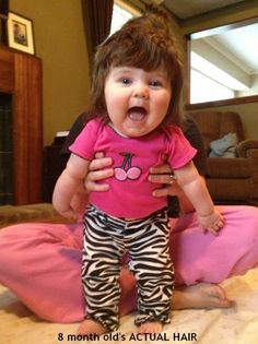 Cute Little Baby Girl with Rockstar Hair ---- funny pictures hilarious jokes meme humor walmart fails