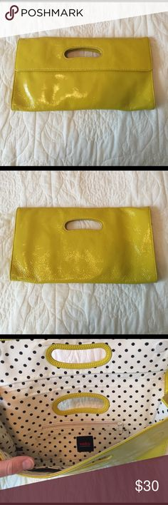 Hobo International Clutch Mustard yellow patent leather Hobo International clutch with black and white polka dot lining. Several pockets for cards on inside. Some small and barely noticeable signs of wear as shown by photos. HOBO Bags Clutches & Wristlets