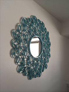 Pinterest copycat. $10. Made from toilet paper rolls. You can find the instructions here: http://made2style.com/2012/07/10/toilet-paper-roll-wall-art/