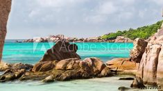 Stock Footage of Daytime scenic timelapse view through granite rocks of Anse Cocos beach with scattered clouds on sunny day. Explore similar videos at Adobe Stock Stock Video, High Quality Images, Sunny Days, Stock Footage, Granite, Sunnies, Adobe, Rocks, Tropical