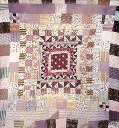 "Multi-colored cotton framed quilt with 9 borders. The quilt has wool wadding and was hand-pieced and hand-quilted. On the reverse, in the corner, is worked ""G Spiller May 1 1839"" in red crosstitch.    This quilt originally was orginally owned by Averil Colby, who repaired the quilt using fabrics from her collection that matched the quilt's date of production. Dated 1839."