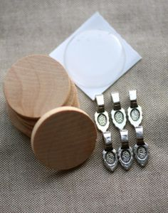 Round Wooden Tile Charms Kit - 75% off  at The Plaid Barn. Each deal includes 18 pieces... enough supplies to create 6 beautiful custom charms.     You'll receive:   6 – 1 inch unfinished round wooden circles  6 – 1 inch clear round epoxy stickers   6 – bails in your choice of silver or antique bronze