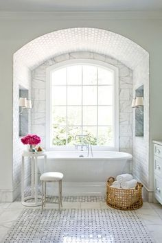 Traditional Master Bathroom with Signature hardware henley cast iron double-ended pedestal tub, complex marble tile floors