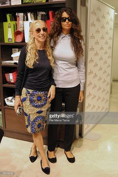 Franca Sozzani and Jnifen Afef attend a presentation of the book 'Just Me' autobiography of Roberto Cavalli at Mondadori Bookstore on September 16, 2013 in Milan, Italy.