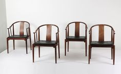 "Hans Wegner ""China"" chairs, 1944. Manufactured by Fritz Hansen.  Rosewood and black leather."