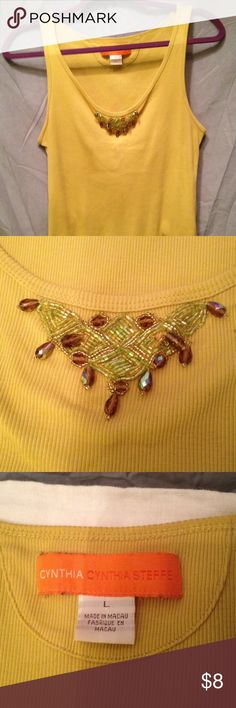 """Cynthia Steffe Jeweled Tank Top Sz L Cynthia Steffe ribbed tank top embellished with iridescent beading and teardrop aurora borealis beads. 100% cotton in light yellow mustard color. 22"""" in length.  Very good preowned condition.  No stains, no loose no missing beads. Sz L Cynthia Steffe Tops Tank Tops"""