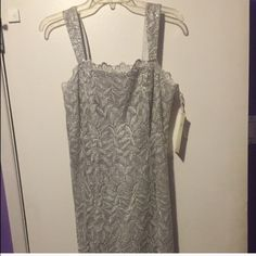 NEW!! Floral Silver Dress Brand new, never worn, cute Aspeed silver dress, perfect for a party or a night out! Says size large, but looks more like a medium/size 8. Comes with a matching scarf. Not Victoria's Secret! Make offers! Victoria's Secret Dresses Midi