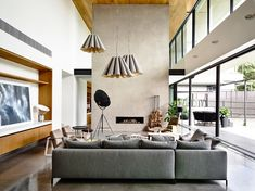 The Concrete House by Matt Gibson Architecture + Design is a stunning modern masterpiece that m...