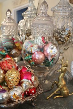 I have all my Mom's ornaments like these......this is a good idea for displaying them.