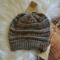 << Multi Color Cute CC Trendy Boutique Beanie Hat The hottest trend this winter! This beanie is a super cute and unique twist on the solid color CC Beanie everyone's wearing!  100% Acrylic Boutique  Accessories Hats