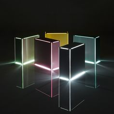 The Neon table light is very much 'a trick of the light' in that it isn't really neon but gives off a similar bright radiant glow. A conventional energy saving bulb illuminates the colored internal surfaces of a folded steel box, made visible through slim linear openings that trace the form and remind us of familiar strip lights. Partly inspired by the works of American artist Dan Flavin, the light can be used individually or grouped together in various sculptural configurations. 200 x 90 x…