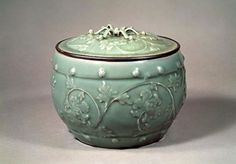 Drum-shaped water jar with applied peony design reliefs, celadon Important Cultural Property Southern Song-Yuan dynasty, century Long-quan ware.