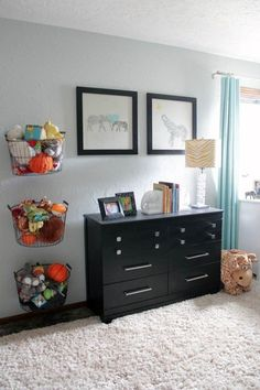 Hang simple wire baskets and fill them with your little one's burgeoning collection of stuffed animals