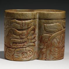 Late Chavin stone double beaker with supernatural animals, Ca. 700-400 B.C.  © Sotheby's