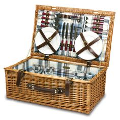 The Newbury is an English-Style picnic basket with service for four. Made of willow and fully lined. Includes wine glasses, plates, utensils and a steel, waiter-style corkscrew. $129.95