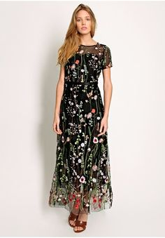 Black botanical embroidered maxi dress with round neckline, short sleeves and hidden back closure.