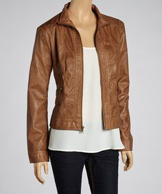 Sleek and sophisticated, this zip-up jacket impresses with artfully stitched seams and a minimalist neckline. Pockets provide precious space to warm the hands, while pliable faux leather imparts a modern finish.