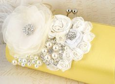 Bridal Clutch-Party Clutch in Lemon Yellow, White and Ivory with Handmade Flowers, Ostrich Plumes, Brooches, Pearls, and Jewels. $130.00, via Etsy.