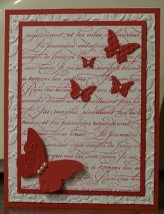 Inspired by my friend Jen (or possibly partially CASEd). Whisper white, Ruby Red paper&ink, En Francais stamp, Beautiful wings embosslit, halfback pearls, vintage wallpaper embossing folder - all Stampin' Up.  Also made one in burgundy.