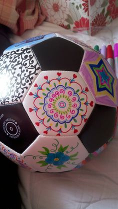 Decorated soccer balls, made to order.
