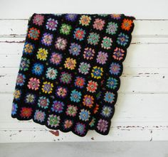 Colorful Crocheted Granny Square Afghan Quilt with Black Border